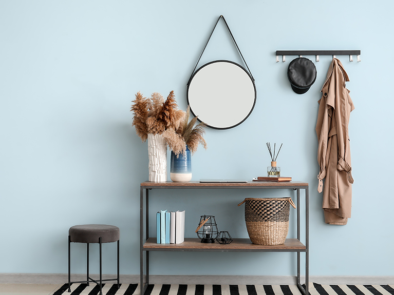 entryway decor with mirror, coat hooks, vases