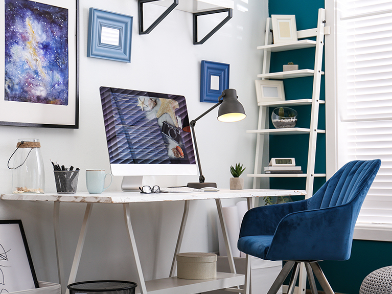 modern desk with blue chair